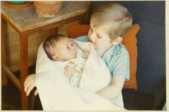 Kevin holding me (9 Days Old)
